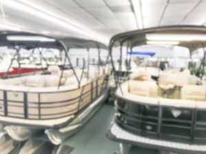 Motion blurred inside a large boat dealer selling variety of new and used boats